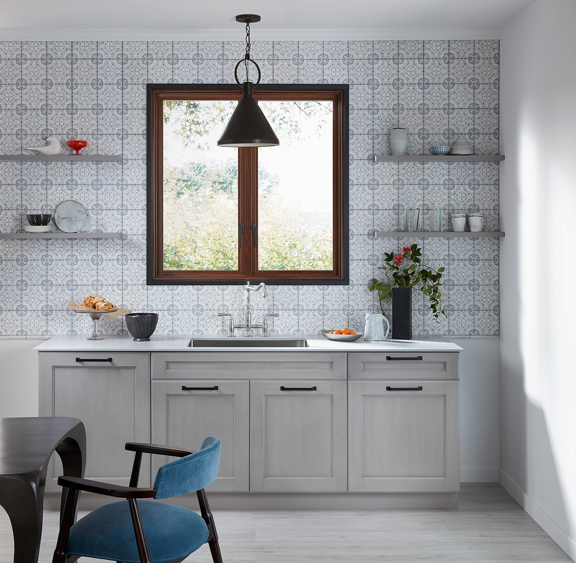 kitchen sink and counter with patterned backsplash